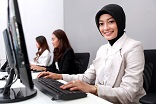 businesswoman smiling while working at office